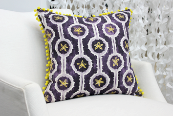 purple leap pillow on a white chair